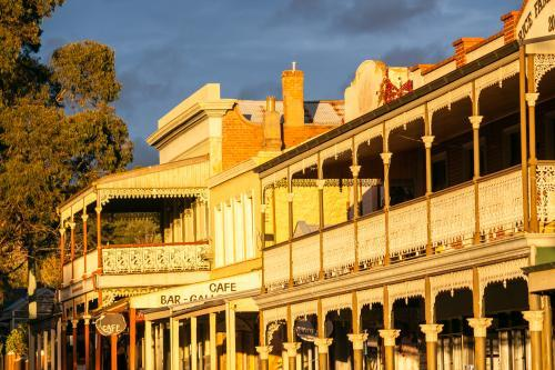 A row of historic buildings with verandahs.