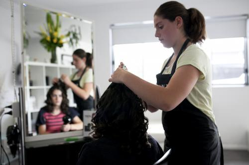 Hairdresser styling a woman's hair