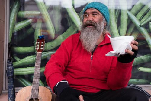 Indigenous Australian Man Having a Break from Busking