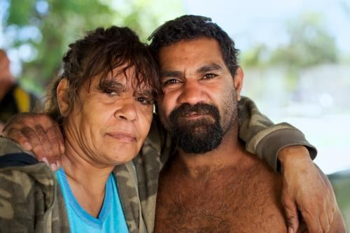 Indigenous Woman with Arm around Man