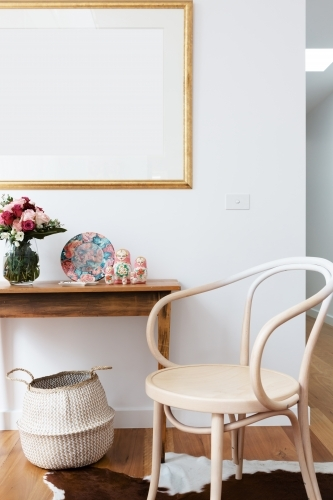 Interior decoration styled with chair and side table and blank wall frame