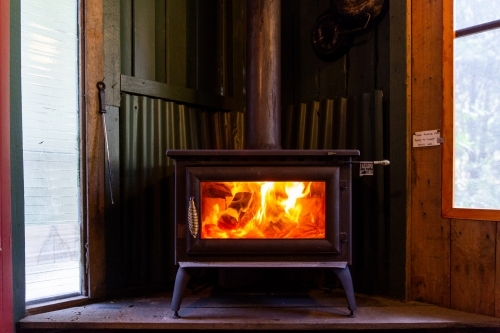 Inviting fireplace in rustic cabin on a cold winters day