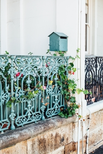 Iron fence and letterbox in front of terrace