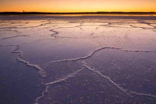 Irregular patterns on a salt lake at dawn