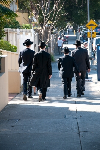 Jewish people walking down the street