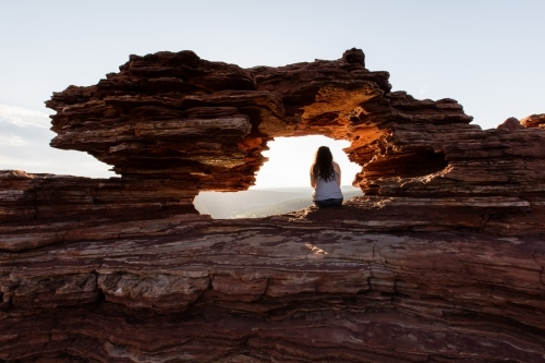 Kalbarri's Nature's Window with girl viewing the gorges at sunrise