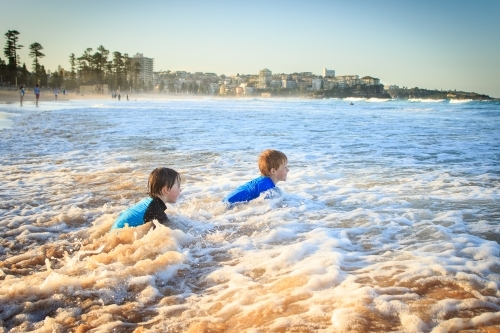 Kids swimming at the beach, Manly, Sydney, Australia