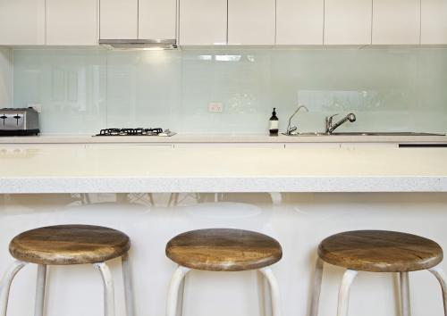 Three kitchen island stools in modern townhouse