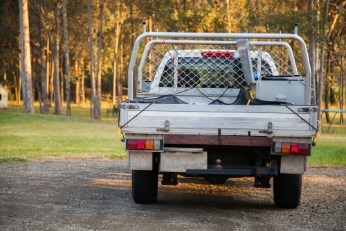 Trades persons work ute parked in backyard