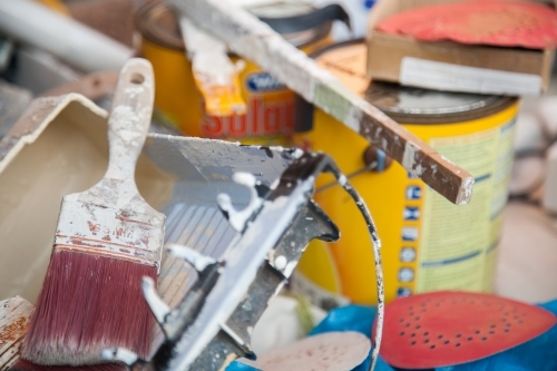 Pile of tradie painters equipment and paintbrush