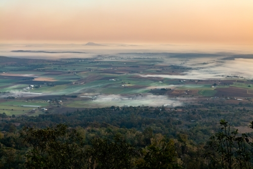 Landscape with early morning  fog and low clouds in the Scenic Rim