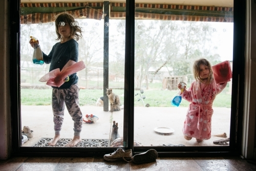 Girls cleaning windows