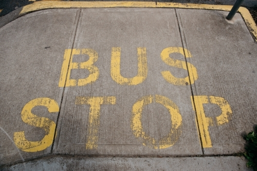 Bus Stop sign painted on pavement