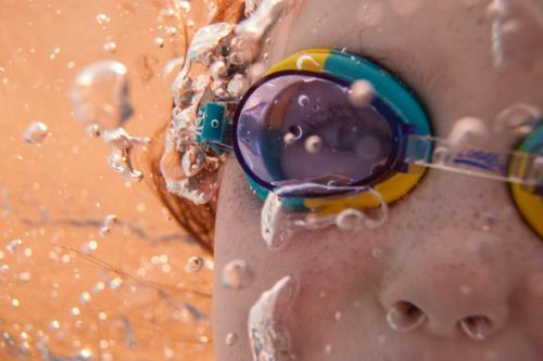 Underwater close up of girl wearing goggles