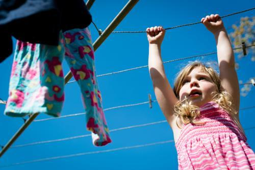 Little girl at the clothesline