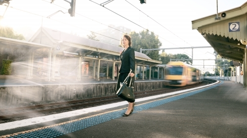 Working woman at train station