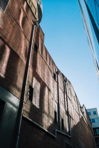 Light falling on old warehouse conversion in Melbourne laneway