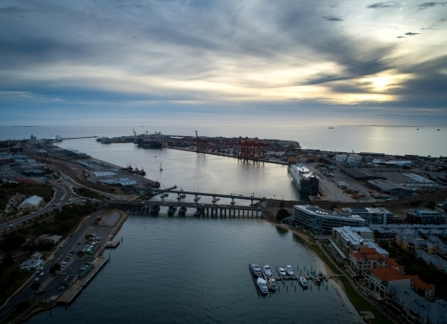 Light pierces cloud in an aerial view over a port