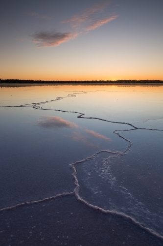 Lines on a salt lake with colourful dawn sky