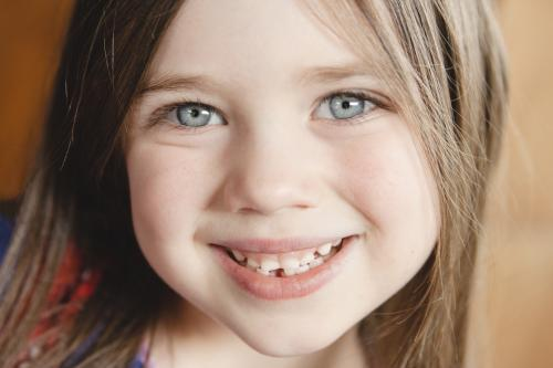 Little girl first lost tooth