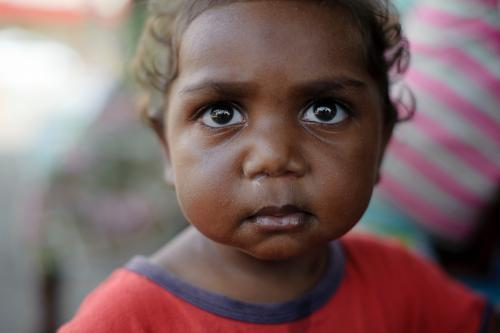 Little Indigenous Australian Girl with Big Brown Eyes