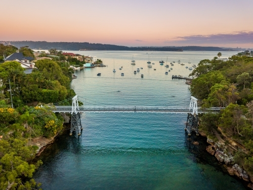 Little narrow cove in Sydney Harbour called Parsley Bay with a distinctive pedestrian bridge.