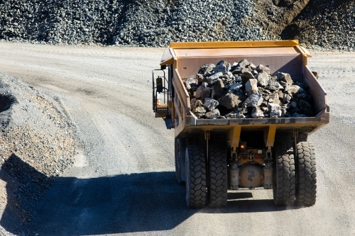 Loaded dump truck moving rock at a quarry mine