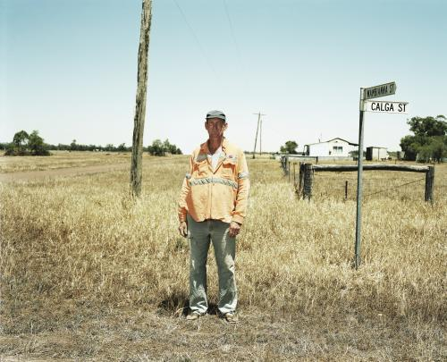Local man standing on roadside in remote town