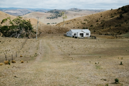 Lone White House in Paddock in Central Highlands Tasmania