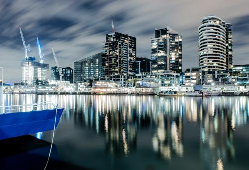 Long exposure of docklands and lights of city buildings at night