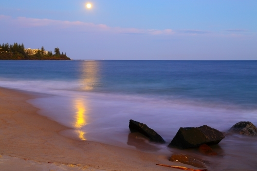 Long exposure of the supermoon full moon rising over Kings Beach, Caloundra