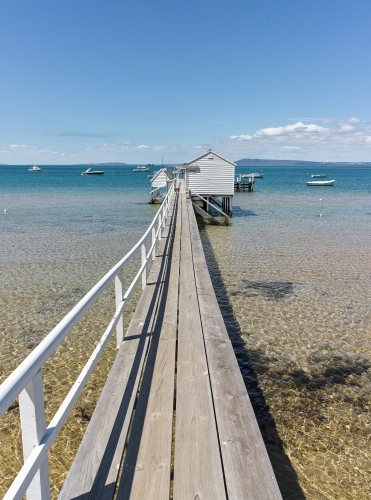Long jetty leading to a boat shed