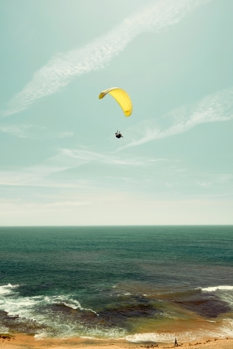 Yellow parachute on the coast with a horizon