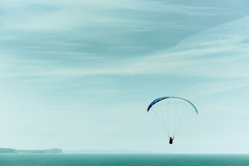 Paragliding into a beautiful sky alone