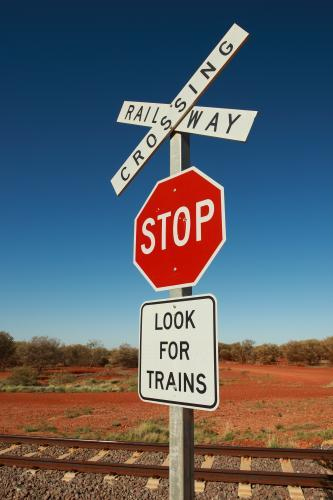 Image of Look for trains railway crossing sign in the