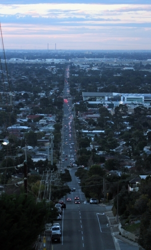 Looking down main road that leads to the port in Adelaide at dusk