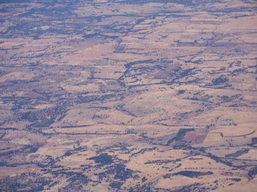 Looking down on dry, undulating, outback hills