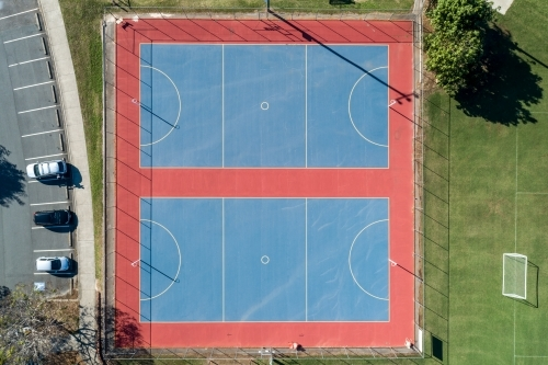 Looking down on two netball courts.
