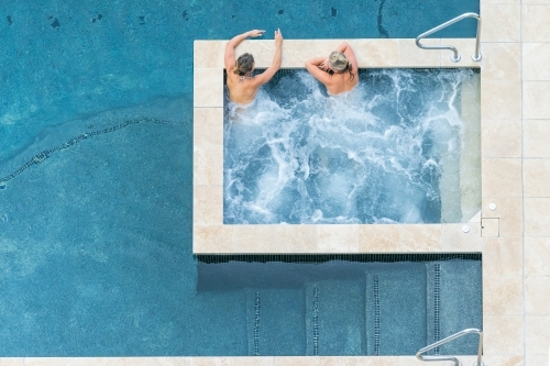 Looking down on two women relaxing in a bubbling spa