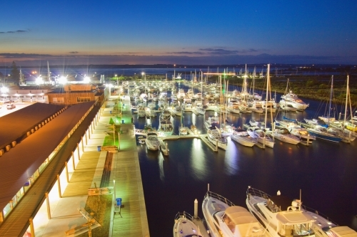 Looking down over a boat marina at twilight