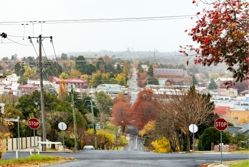 Looking down the street surrounded by red autumn trees in small country town