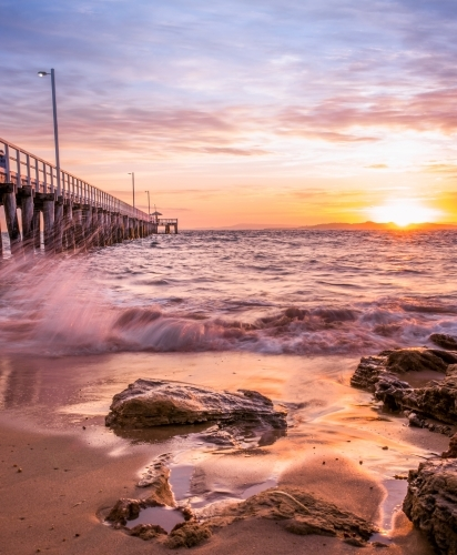 Low angle view of jetty at Point Lonsdale in sunrise light