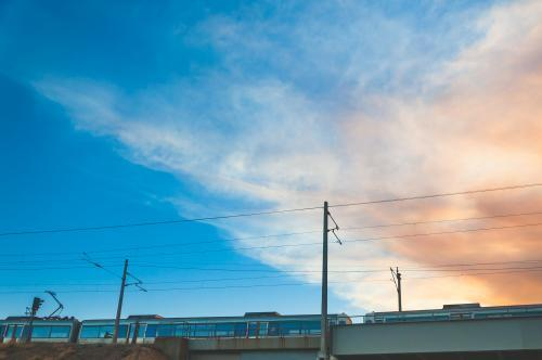Low view of electric train passing with pretty sky behind