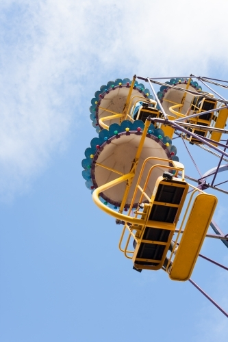 People on a ferris wheel at a city fun park