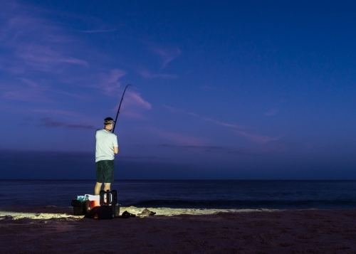 Man Beach Fishing in the Early Morning