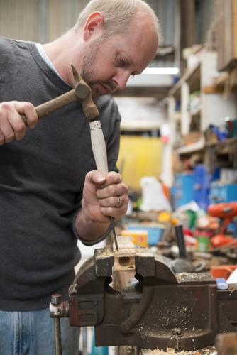 Man learning woodwork in the shed