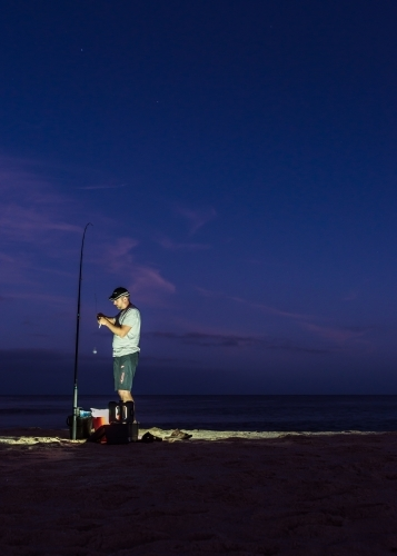 Man Preparing For Pre Dawn Fishing