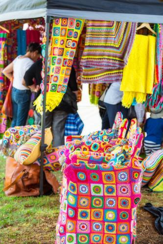 Market stall of brightly coloured crocheted items.