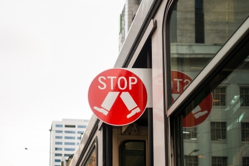 Melbourne, Australia - Aug 9, 2017: An extensile STOP sign on the tram.
