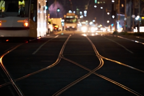 Melbourne streets at night with trams